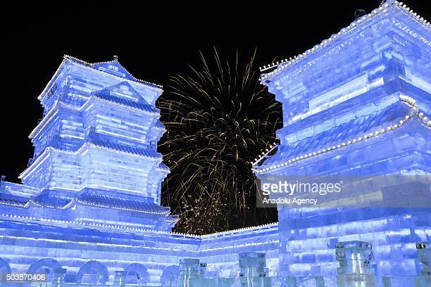 Firework display is seen behind the ice towers during the 32nd Harbin Ice Festival in Harbin China on January 6 2016 The main attraction is the...