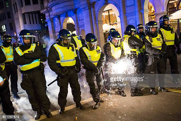 A firework is fired at a line of police by protesters during the Million Mask March on November 5 2016 in London England Thousands of demonstrators...