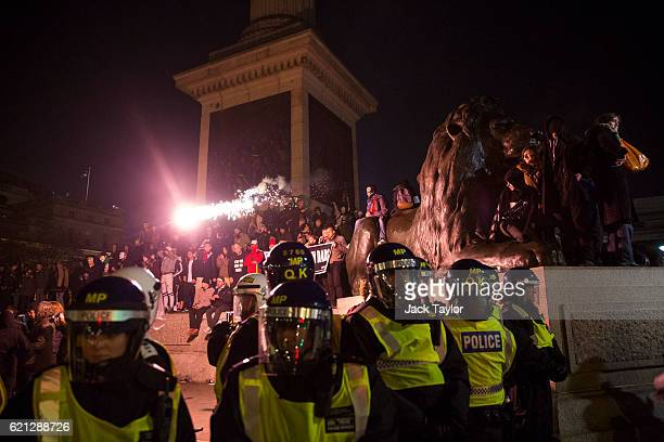 A firework is fired at police as masked protesters gather in Trafalgar Square during the Million Mask March on November 5 2016 in London England...