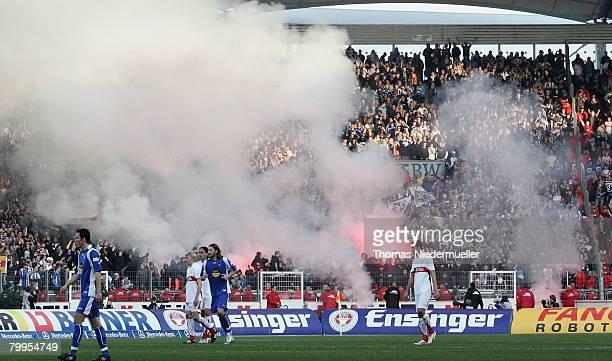 Firework is seen in the Karlsruhe bloc during the Bundesliga match between VfB Stuttgart and SC Karlsruhe at the Gottlieb Daimler stadium on February...