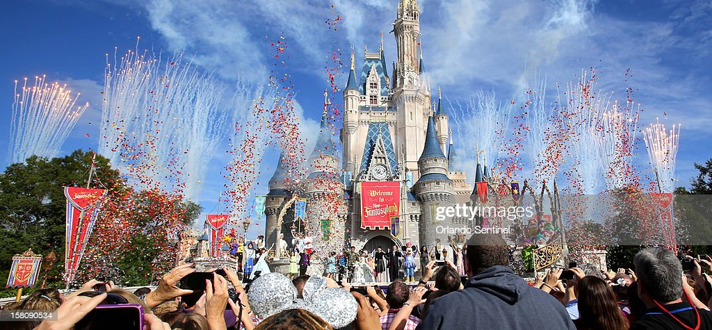 Fireworks and confetti fly over Cinderella Castle during the grand opening ceremony for the New Fantasyland at Walt Disney World's Magic Kingdom...
