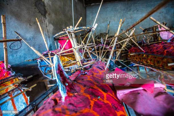 Fireworks and crackers fixed onto the dragon is seen on June 19 2017 in Meizhou Guangdong Province of China The fire dragon dance of Puzhai Town at...