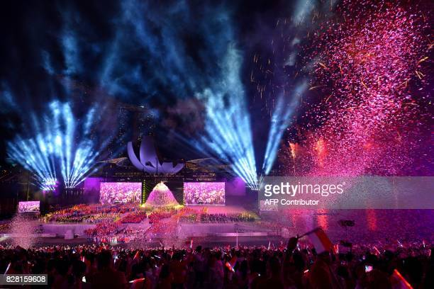 A fireworks and lights show illuminates the sky during the 52nd Singapore National Day celebration in Singapore on August 9 2017 / AFP PHOTO / ROSLAN...