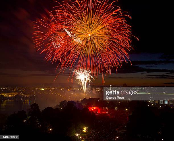 Fireworks are displayed over the Alexandra Bridge and National Gallery as viewed from Parliament Hill as thousands gather to celebrate Canada Day on...