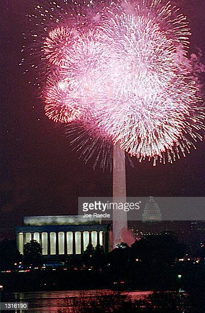 Fireworks are displayed over the Washington National Mall during the Presidential Inaugural Opening Celebration January 18 2001 in Washington DC