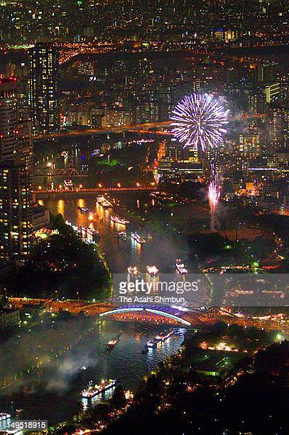 Fireworks are let off during the Tenjin Festival 'Funatogyo' that 100 ships cruising at Okawa on July 25 2012 in Osaka Japan