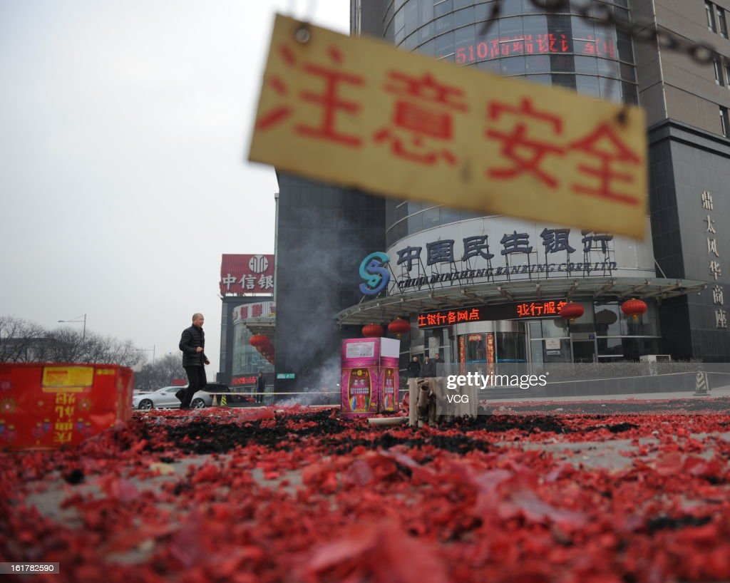 Fireworks are seen after lighting on a road on February 16, 2013 in Taiyuan, Shanxi Province of China. Local businesses in China rushed to set off fireworks ahead of the first business day after the New Year, as people believe it brings a propitious omen for the business during the year.