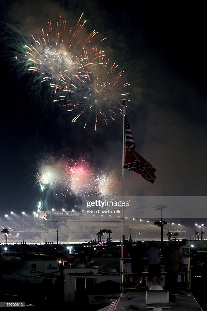 Fireworks are seen after the NASCAR XFINITY Series Subway Firecracker 250 Powered By CocaCola at Daytona International Speedway on July 4 2015 in...