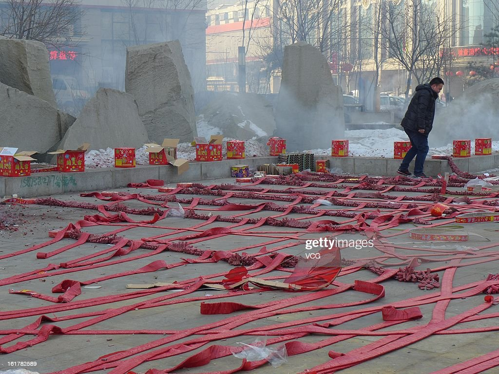 Fireworks are seen before lighting on a road on February 16, 2013 in Shenyang, Liaoning Province of China. Local businesses in China rushed to set off fireworks ahead of the first business day after the New Year, as people believe it brings a propitious omen for the business during the year.