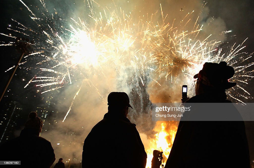 Fireworks are seen during 'Jwibulnoli' a South Korean folk game at Han River on February 5, 2012 in Seoul, South Korea. The event is part of a 'Daeboreum', a Korean holiday that celebrates the first full moon of the lunar new year.