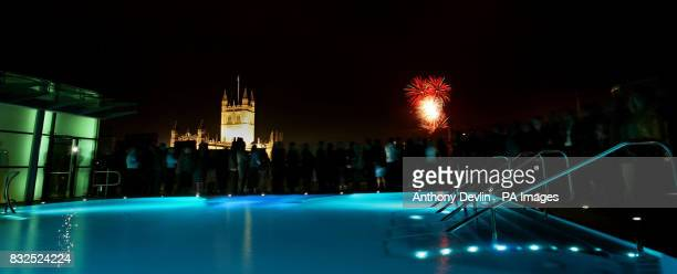 Fireworks are seen over Bath Abbey from the rooftop pool of the new Bath Spa 12000 fireworks costing 80000 and weighing six tonnes were launched from...