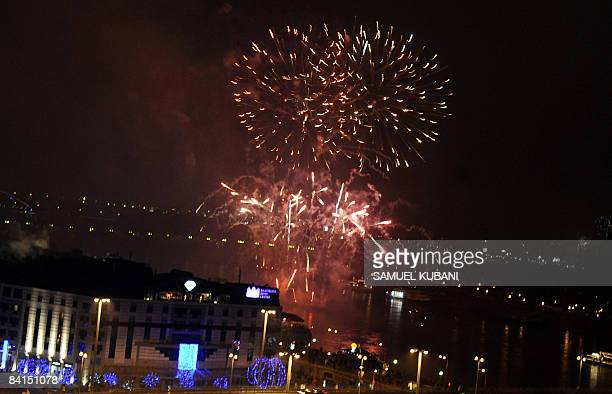 Fireworks are seen over the New bridge as part of the official New Year's Eve celebrations in Bratislava on December 31 2008 AFP PHOTO/Samuel Kubani
