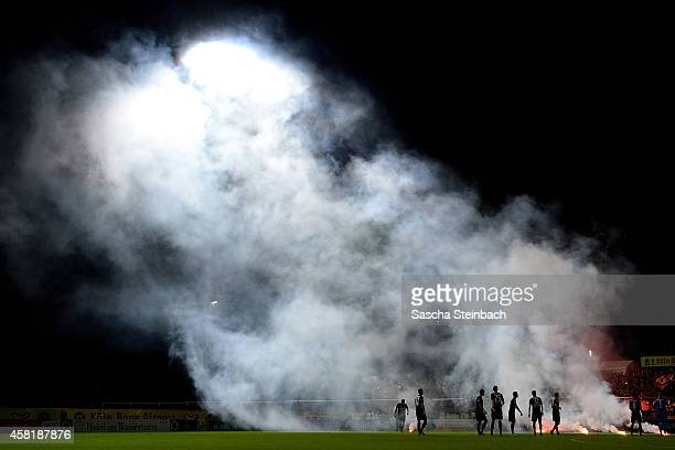 Fireworks are seen prior to the Regionalliga West match between Viktoria Koeln and Alemannia Aachen at Sportpark Hoehenberg on October 31 2014 in...