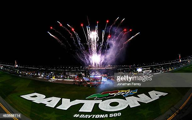 Fireworks are set off as part of prerace ceremonies for the NASCAR Sprint Cup Series Budweiser Duel 1 at Daytona International Speedway on February...