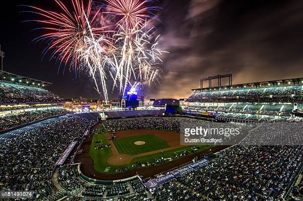 Fireworks are set over the field as spectators fill the outfield after a game between the Colorado Rockies and the Arizona Diamondbacks at Coors...
