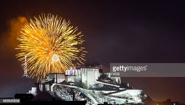 Fireworks are shot to welcome Tibetan New Year on February 19 2015 in Lhasa Tibetan of China People in eastern China's Tibetan Autonomous Region...