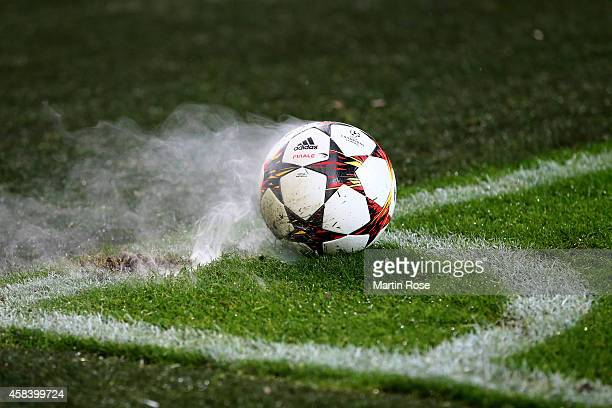 Fireworks are thrown onto the pitch by the Galatasaray fans during the UEFA Champions League Group D match between Borussia Dortmund and Galatasaray...