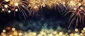 Defocused fireworks and bokeh at New Year and copy space. Abstract background holiday.