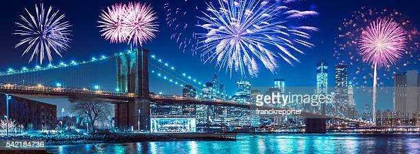 fireworks behind the brooklyn bridge