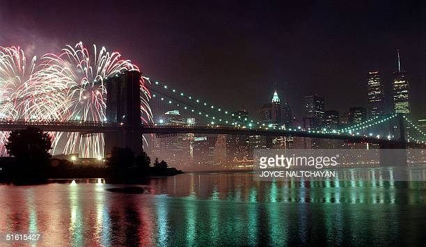 Fireworks burst above the Brooklyn Bridge during a 4th of July celebration 04 July 1999 in New York City The US celebrated its 223rd year of...