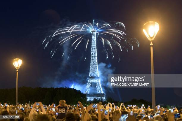Fireworks burst above the Eiffel Tower in Paris on July 14 2015 as part of France's annual Bastille Day celebrations AFP PHOTO / FRANCOIS XAVIER MARIT