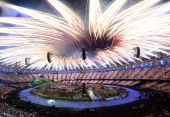 Fireworks burst above the stadium during the Opening Ceremony of the London 2012 Olympic Games at the Olympic Stadium on July 27 2012 in London...