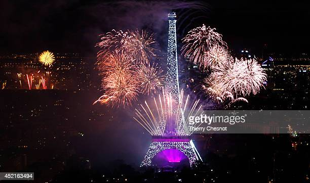 Fireworks burst around the Eiffel Tower as part of Bastille Day celebrations on July 14 in Paris France Bastille Day commemorates the storming by...