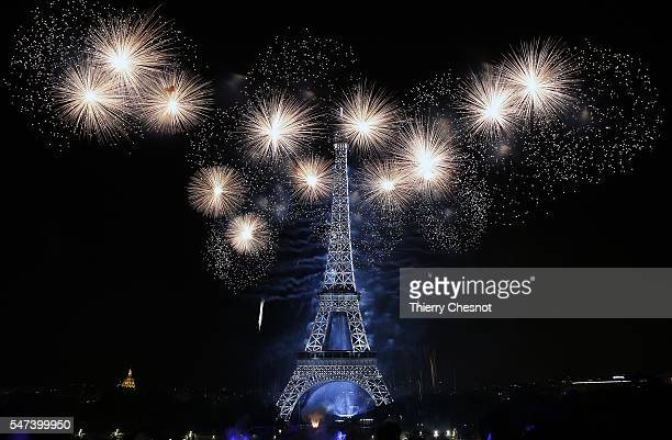 Fireworks burst around the Eiffel Tower as part of Bastille Day celebrations on July 14 2016 in Paris France Bastille Day commemorates the storming...