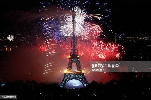 Fireworks burst around the Eiffel Tower as part of France's annual Bastille Day celebrations on July 14 in Paris France Bastille Day commemorates the...