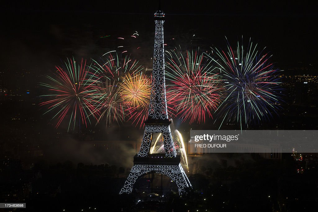 Fireworks burst around the Eiffel Tower in Paris on July 14, 2013 as part of France's annual Bastille Day celebrations.