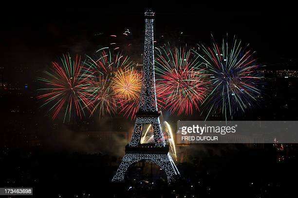 Fireworks burst around the Eiffel Tower in Paris on July 14 2013 as part of France's annual Bastille Day celebrations AFP PHOTO / FRED DUFOUR