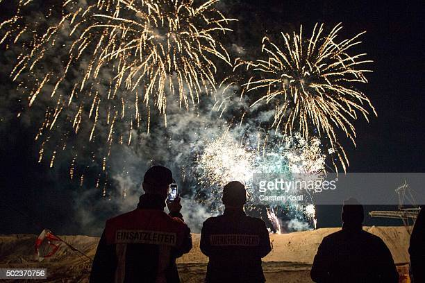 Fireworks burst over the CottbusNord openpit lignite coal mine during an event to mark the mine's closure on December 23 2015 near Cottbus Germany...