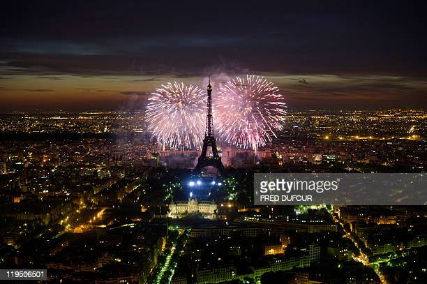 Fireworks burst over the Eiffel Tower during traditional Bastille Day celebrations on July 14 2011 in Paris France held its annual military parade on...