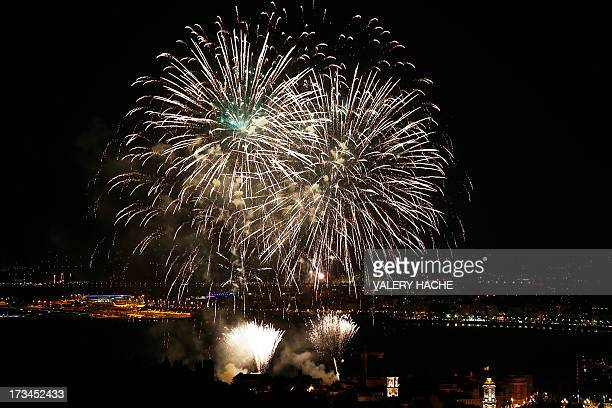 Fireworks burst over the mediterranean bay 'Baie des Anges' in Nice southeastern France on July 14 2013 as part of the annual Bastille Day...