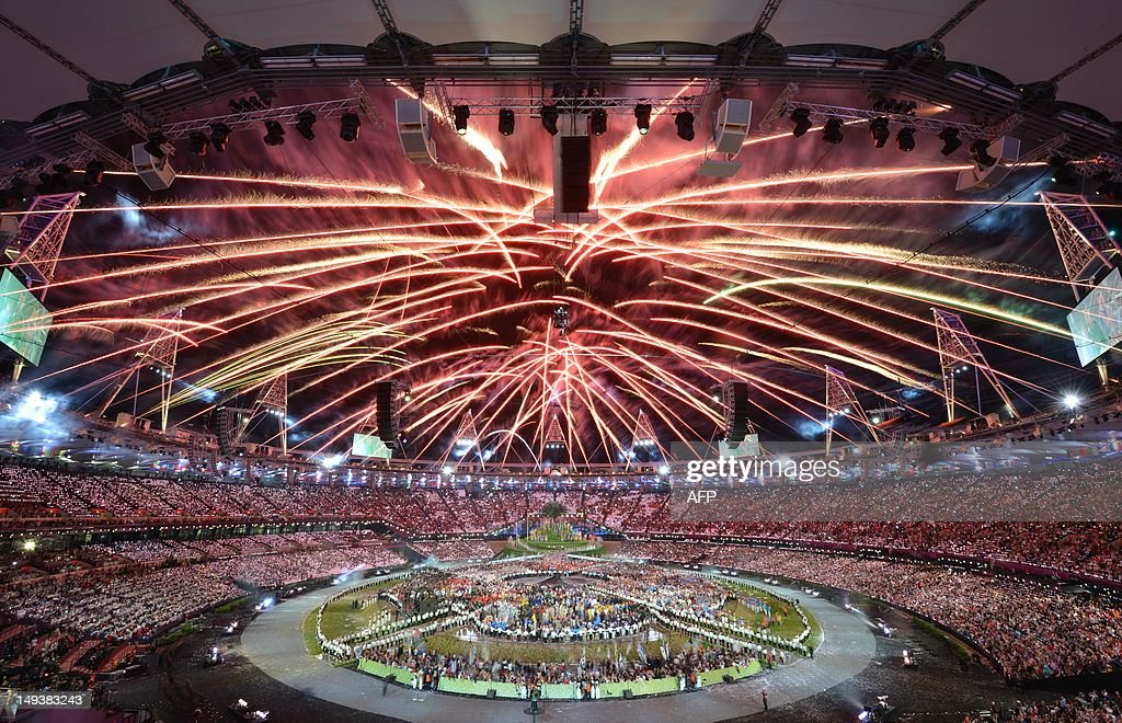 Fireworks burst over the Olympic Stadium during the opening ceremony of the London 2012 Olympic Games on July 27 2012 at the Olympic stadium in...