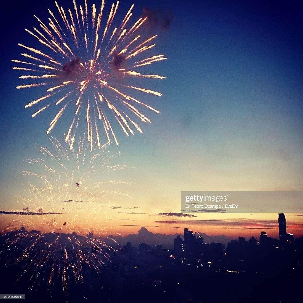 Fireworks Display In Sky During Sunset