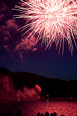 Fireworks display over lake