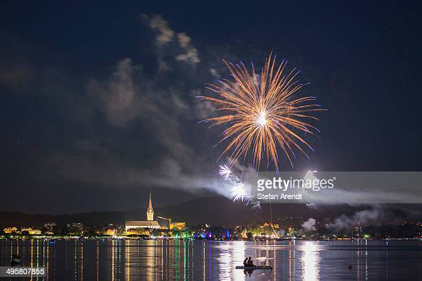 Fireworks during the Hausherrenfest festival, couple on a floating island in Lake Constance at the front, Radolfzell, Baden-Wurttemberg, Germany