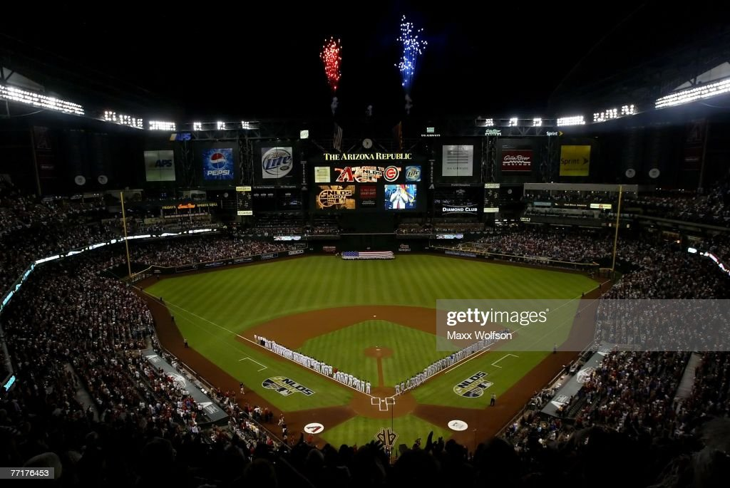 Fireworks erupt during the national anthem before the game between the Arizona Diamondbacks and the Chicago Cubs prior to Game One of the National...