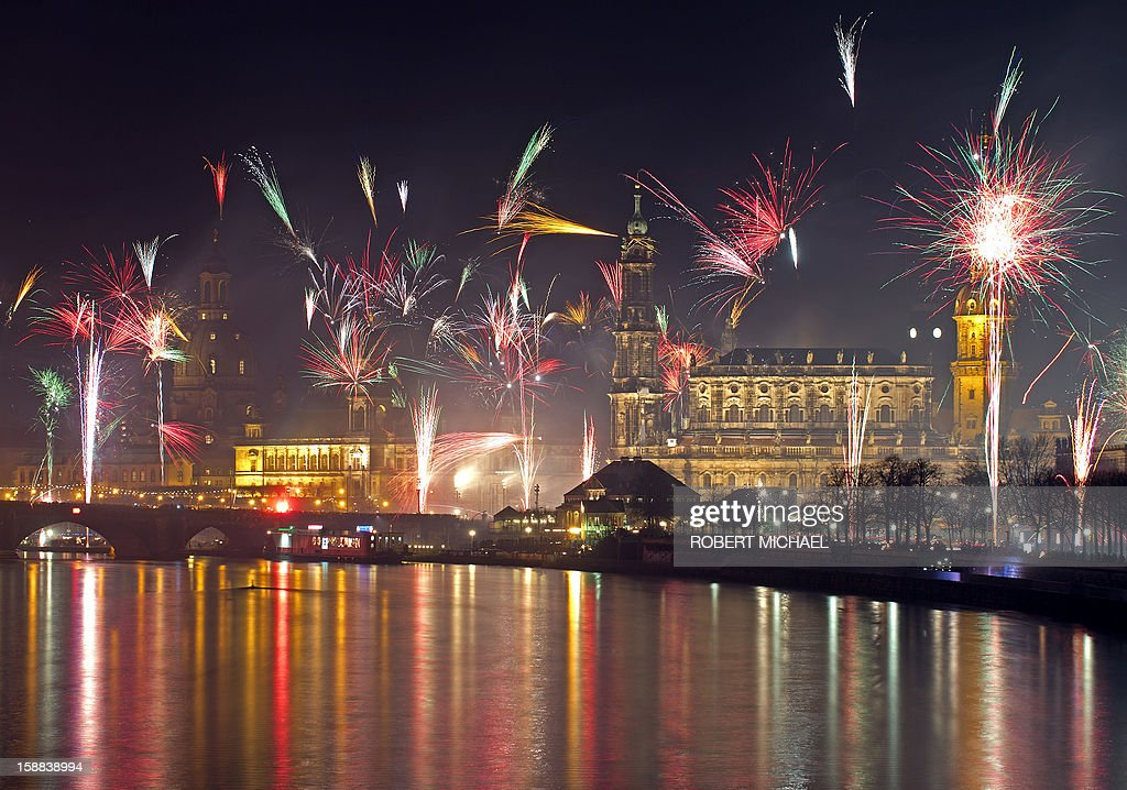Fireworks erupt Fireworks erupt over on the Elbe river in Dresden, eastern Germany on January 1, 2013 during the New Year's celebrations. MICHAEL