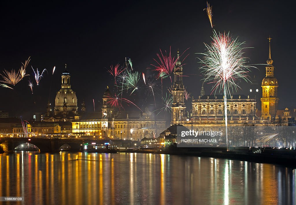 Fireworks erupt over on the Elbe river in Dresden, eastern Germany on January 1, 2013 during the New Year's celebrations.