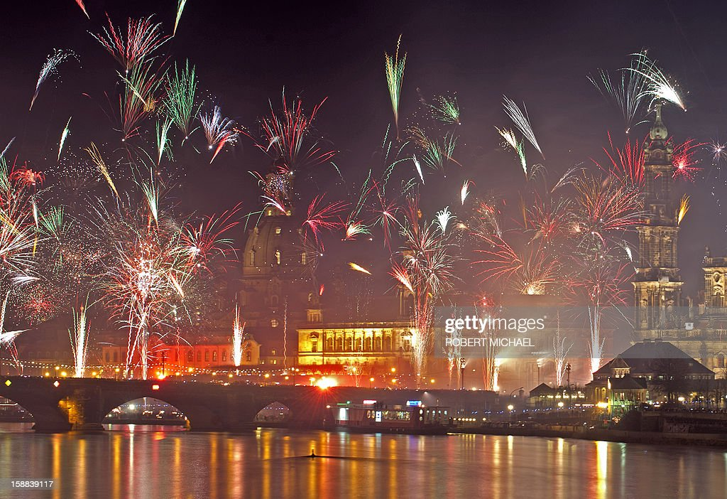 Fireworks erupt over on the Elbe river in Dresden, eastern Germany on January 1, 2013 during the New Year's celebrations. MICHAEL