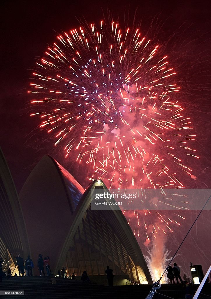 Fireworks erupt over the Sydney Opera House (below) as part of the International Fleet Review in Sydney on October 5, 2013. Britain's Prince Harry is in Sydney for the International Fleet Review as the city plays host to a week of maritime celebrations, including aircraft fly-pasts, helicopter display teams, marching bands and firework displays, with many of the visiting warships here, from countries including Britain, Singapore, Japan and the United States, open to the public. AFP PHOTO / GREG WOOD