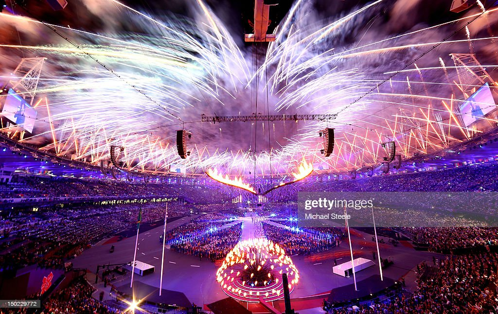 Fireworks expload as the Olympic Cauldron is slowly lowered during the Closing Ceremony on Day 16 of the London 2012 Olympic Games at Olympic Stadium on August 12, 2012 in London, England.