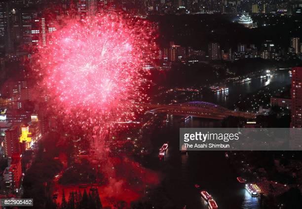 Fireworks explode above Okawa River during the Tenjin Festival on July 24 2017 in Osaka Japan