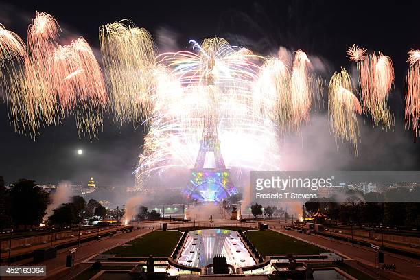 Fireworks explode around the Eiffel Tower during the annual Bastille Day celebrations on July 14 2014 in Paris France The French National Day...
