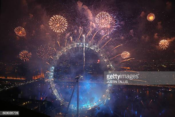 TOPSHOT Fireworks explode around the London Eye during New Year's celebrations in central London just after midnight on January 1 2016 AFP PHOTO /...