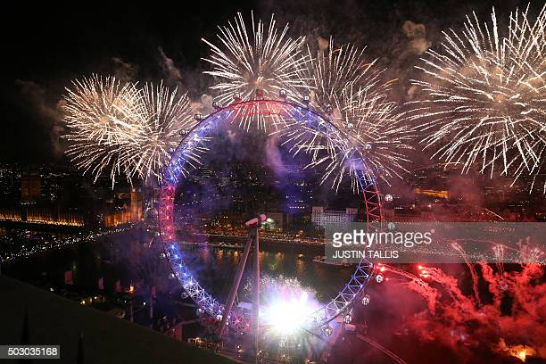 Fireworks explode around the London Eye during the New Year celebrations in central London just after midnight on January 1 2016 AFP PHOTO / JUSTIN...