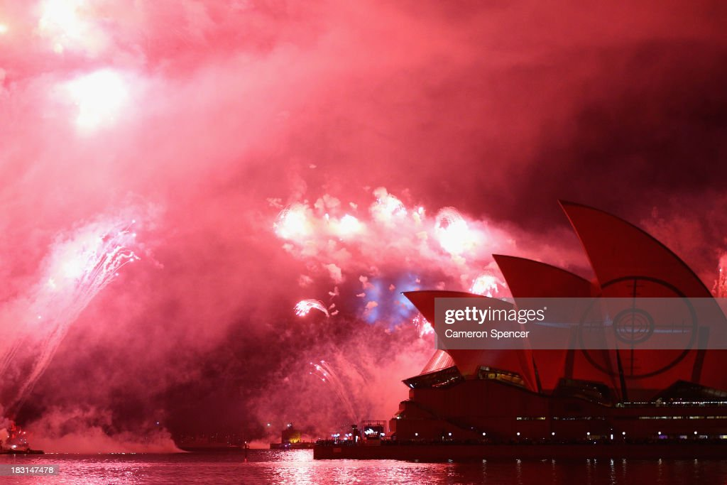 Fireworks explode as projections are displayed on the Sydney Opera House during the International Fleet Review on October 5, 2013 in Sydney, Australia. Over 50 ships participate in the International Fleet Review at Sydney Harbour to commemorate the 100 year anniversary of the Royal Australian Navy's fleet arriving into Sydney. Prince Harry is an official guest of the Australian Government and will take part in the fleet review during his two-day visit to Australia.