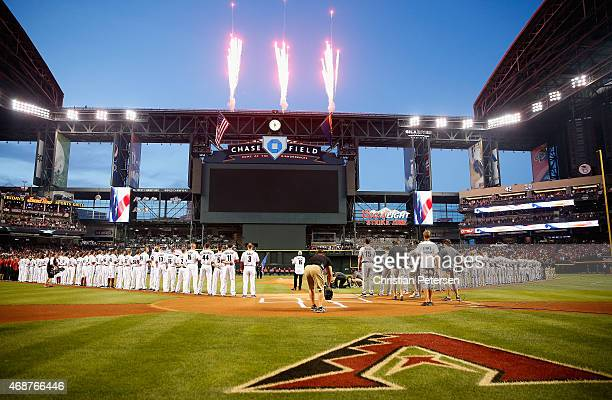 Fireworks explode as the national anthem is perform before the Opening Day MLB game between the Arizona Diamondbacks and the San Francisco Giants at...